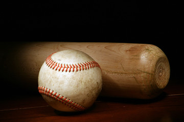 Baseball and Bat on a dark background