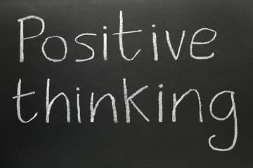 Positive thinking written on a blackboard.