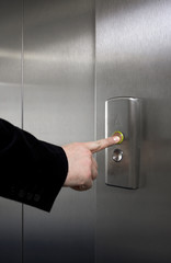Man pressing elevator button