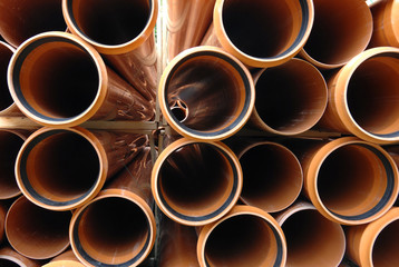 PVC pipes stacked in construction site