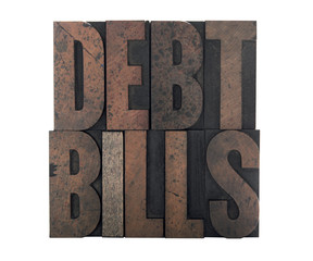 the words 'debt' and 'bills' isolated on white