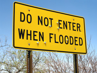 Do not enter when flooded road sign