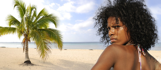 Panorama of tropical beach with young bikini model