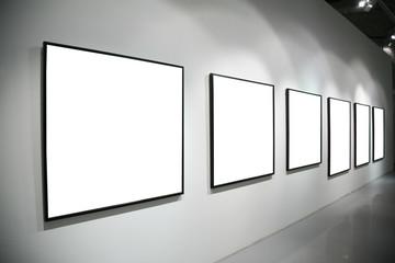 frames on  white wall