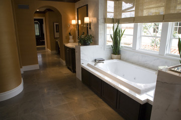 Designer bathroom with a modern tub and tile floor.