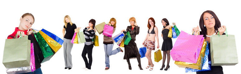 two women shopping and six other