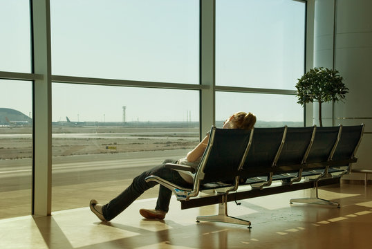 Lonely girl waiting in airport