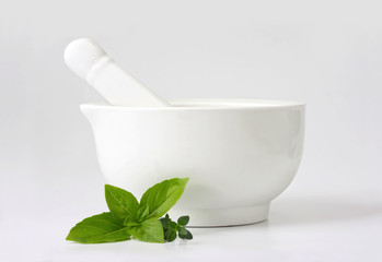 Mortar and Pestle with Basil and Thyme