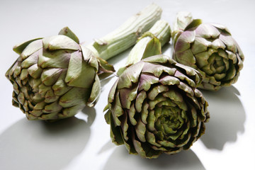 Three fresh artichokes close up