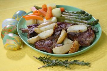Roast lamb with baked potato, carrot, leek and asparagus