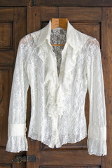 Lace blouse on antique closet