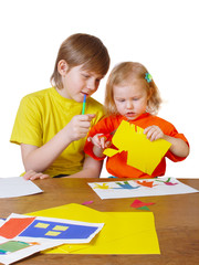 boy and girl with paper
