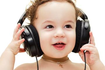 Singing baby wearing headphones