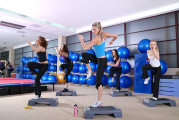 A group of women exercising in the fitness club.
