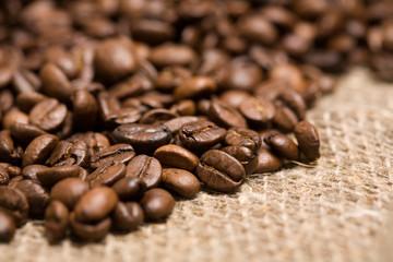 Freshly roasted coffee beans on sackcloth