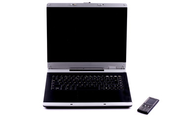 black laptop with a mobile phone