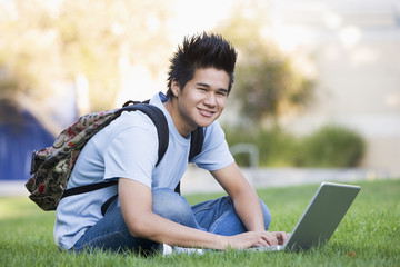 University student with laptop computer