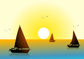 Boats in the sea at sunset