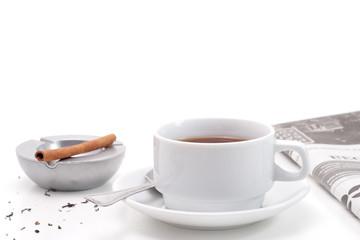 Tea, ashtray and newspaper