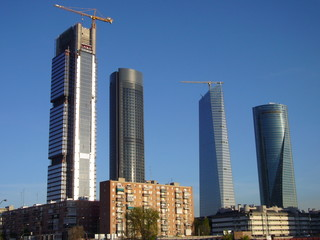 Skyscrapers in contrast with traditional buildings in Madrid