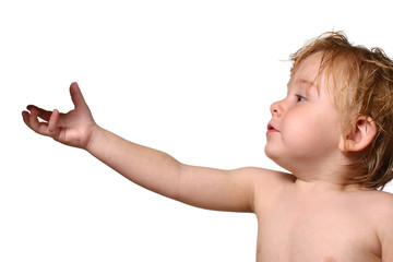 toddler reaching for object