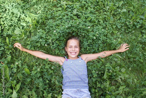 Preteen Girl On Grass Background Royalty Free Stock Images