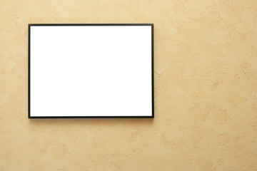 Blank frame over yellow wall