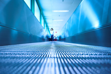 Blue moving escalator in the office hall