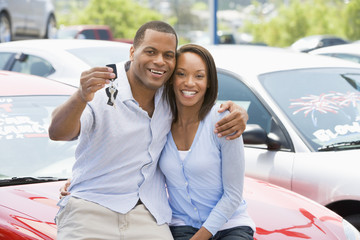 Couple picking up new car