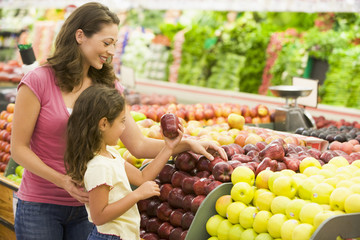 Mother and daughter shopping for fresh produce