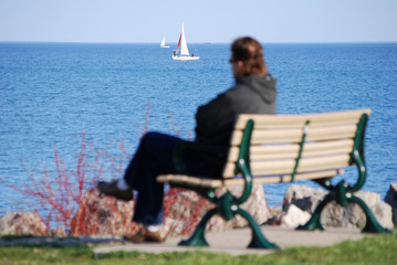 Man watching sail boats