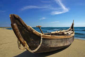 Handmade boat on seacoast