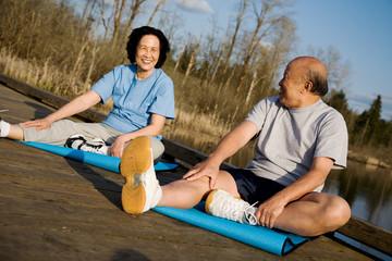 Asian senior couple exercise