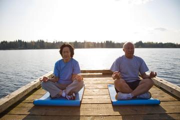 Senior asian couple exercising