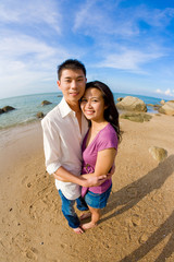 couple hugging on the beach during vacation