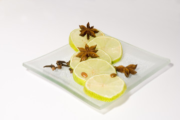 Still-life with lime slices and cinnamon stars