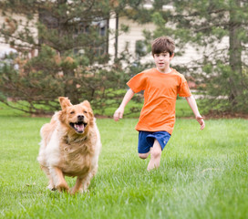 Little Boy Racing the Dog