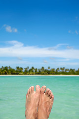 Feet, water and exotic beach