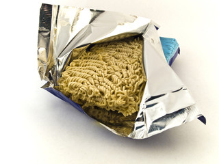 Dried Egg Noodles in Foil on White Background