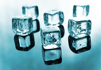 Ice cubes on reflective background