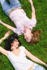 pretty women rest on the green grass