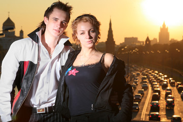 Fotobehang - Young couple in Moscow city at sunset