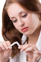 Beautiful girl breaking cigarette. #1