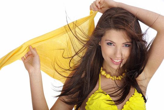 Sexy woman wearing yellow bikini on white background