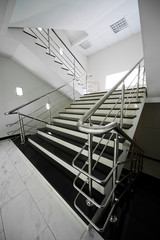 staircase with a steel handrail