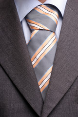Detail of a suit and tie