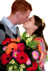 Kissing teenagers with flowers