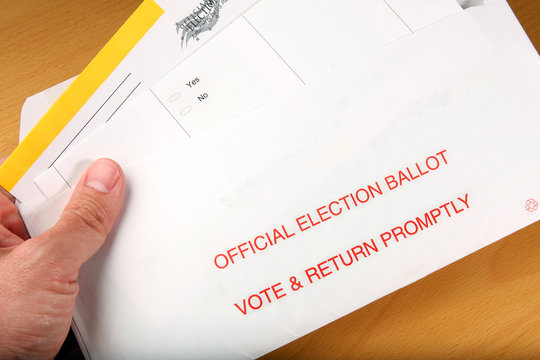 Man opening mail in ballot