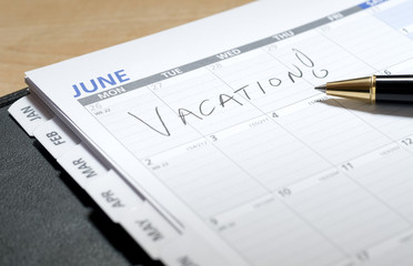 Vacation Written in June on a Calendar