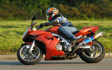 motorcycle rider cornering at speed